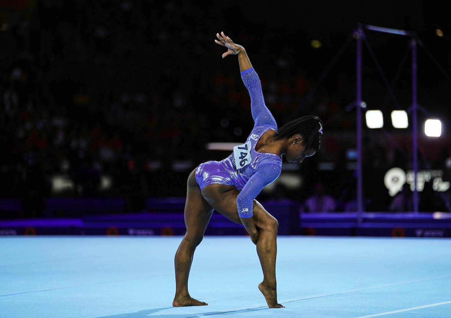 A gymnast performs on floor exercise.