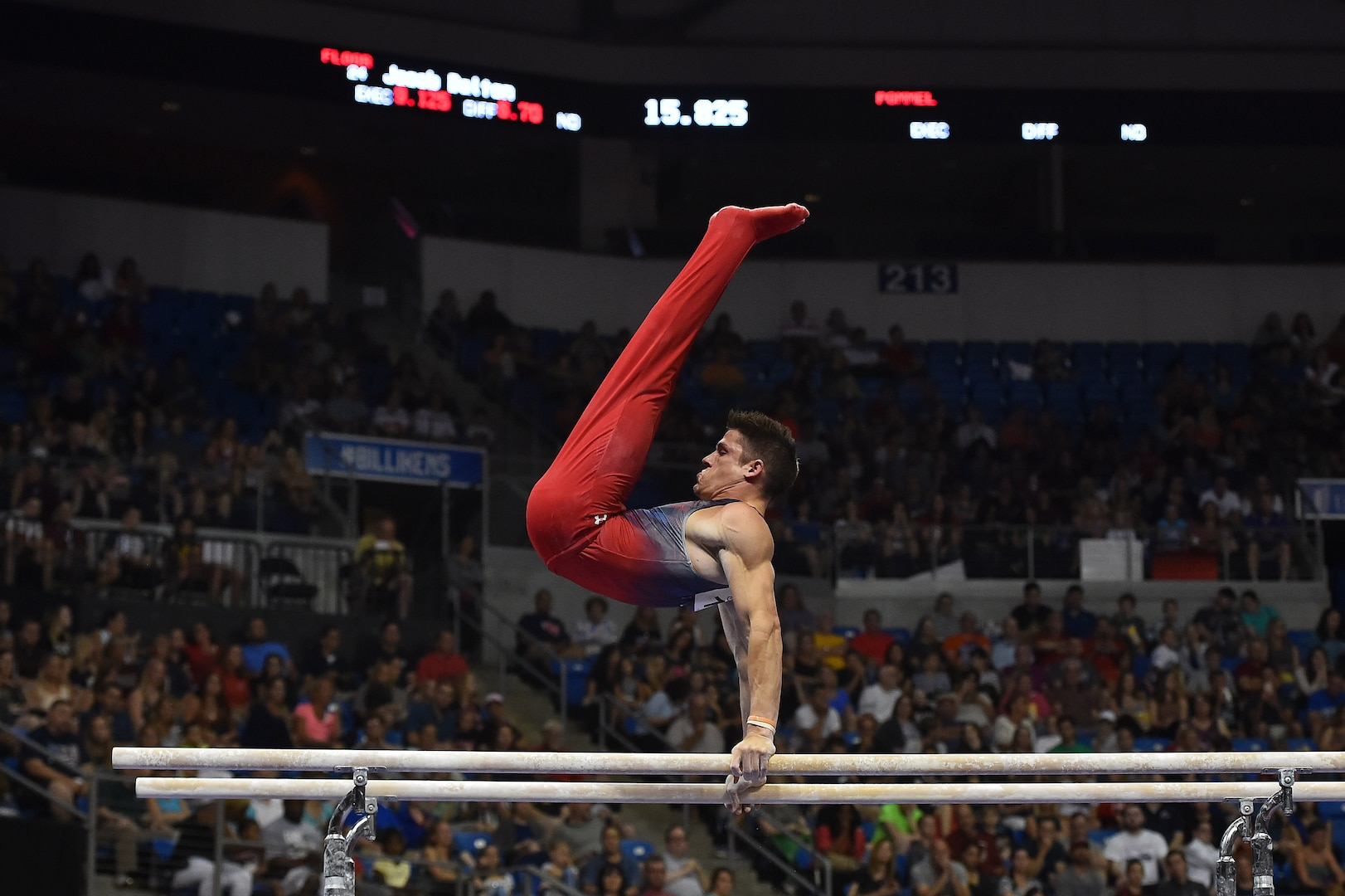 A gymnast swings on the parallel bars.