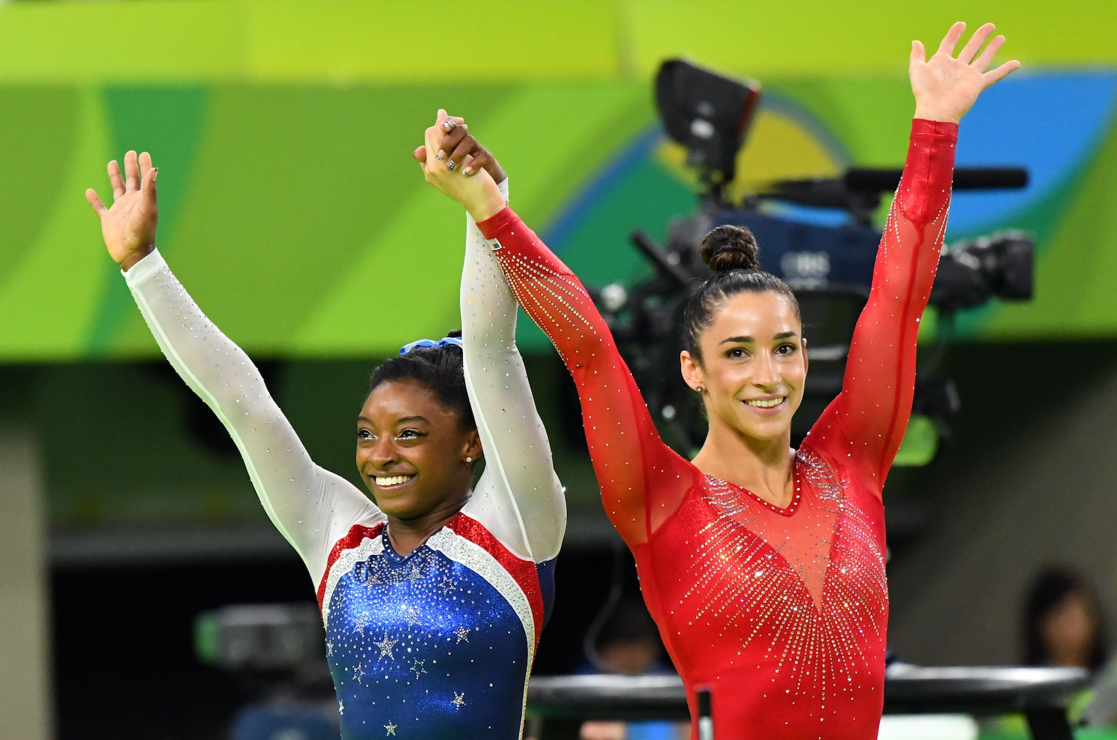 Simone Biles and Aly Raisman celebrate after winning the gold and silver medal, respectively, at the 2016 Rio Games.