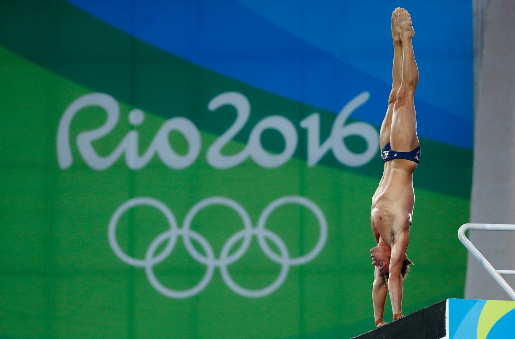 Tom Daley of Great Britain sets up a dive in the armstand position.