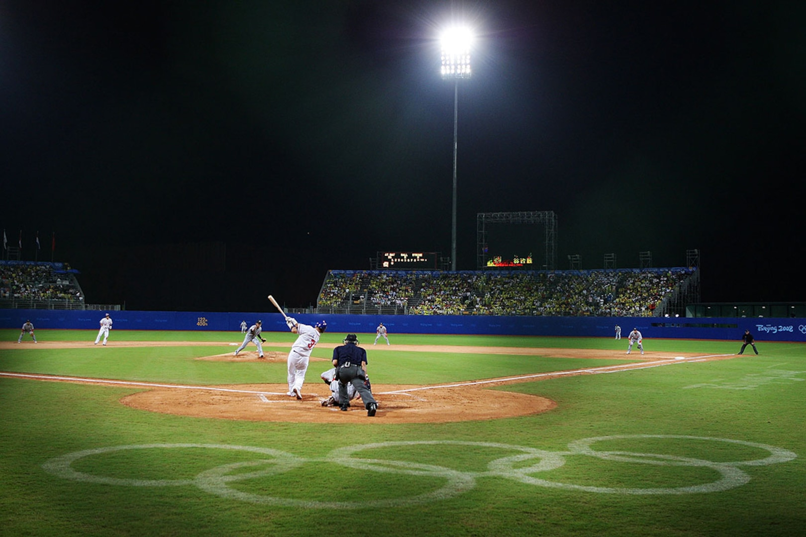 A baseball game played at night during the 2008 Beijing Olympics