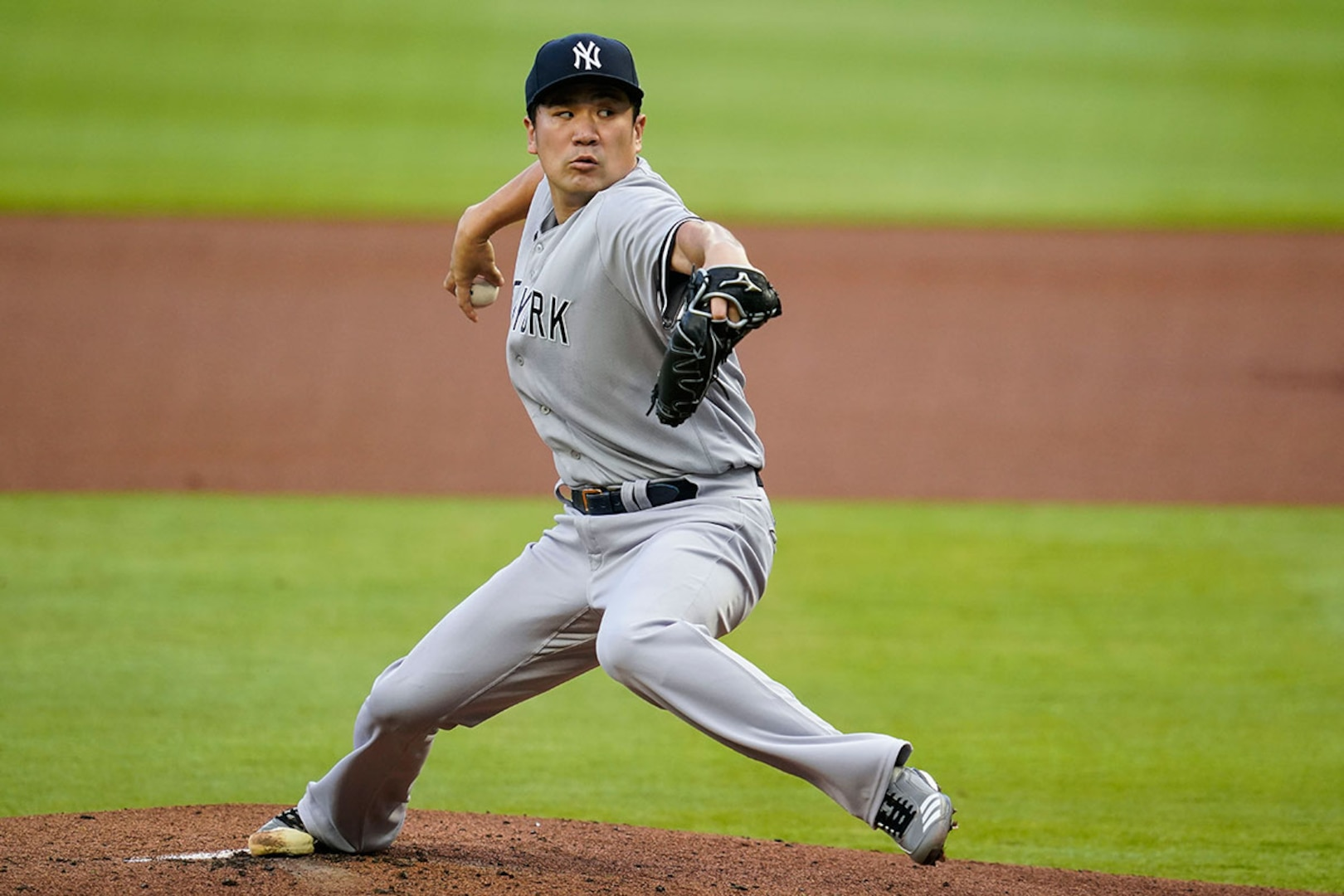 Masahiro Tanaka delivers a pitch while playing for the New York Yankees