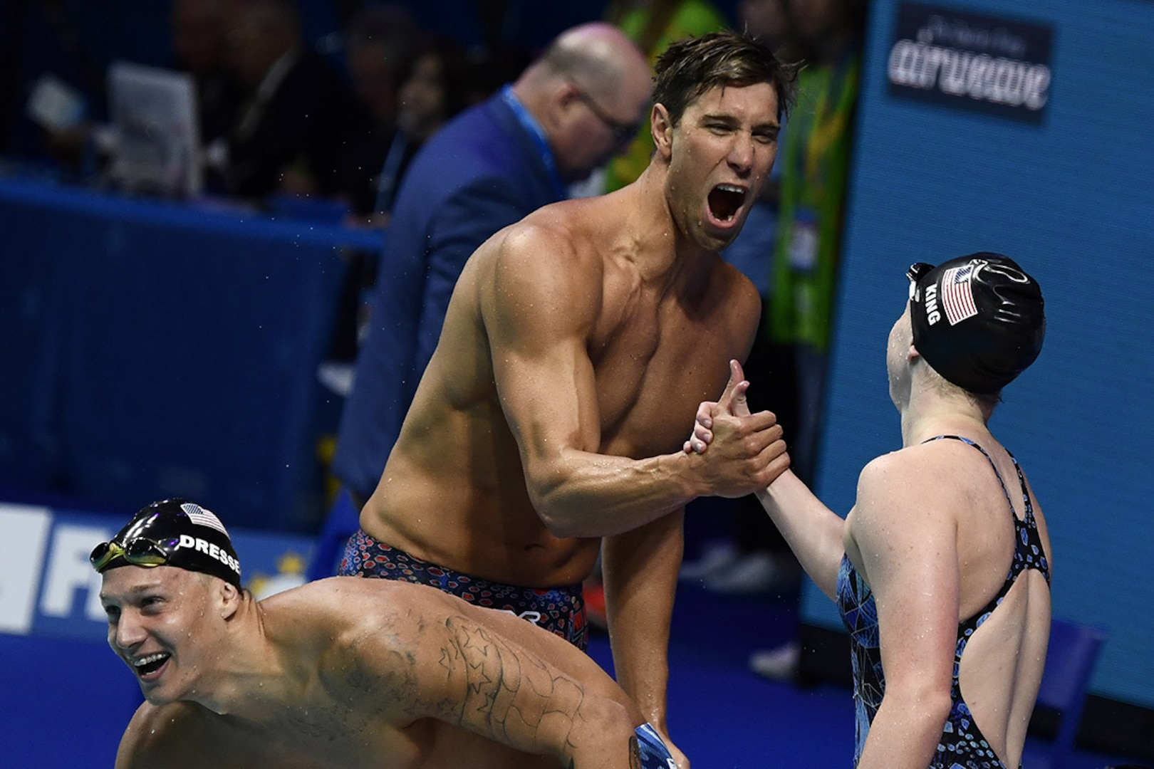 Matt Grevers celebrates with Lilly King after winning mixed relay gold