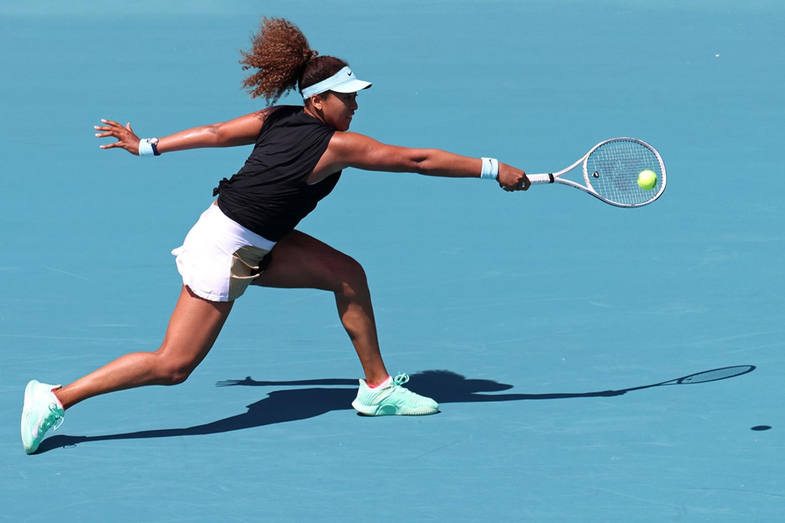Naomi Osaka reaches for a backhand hit during a tennis match