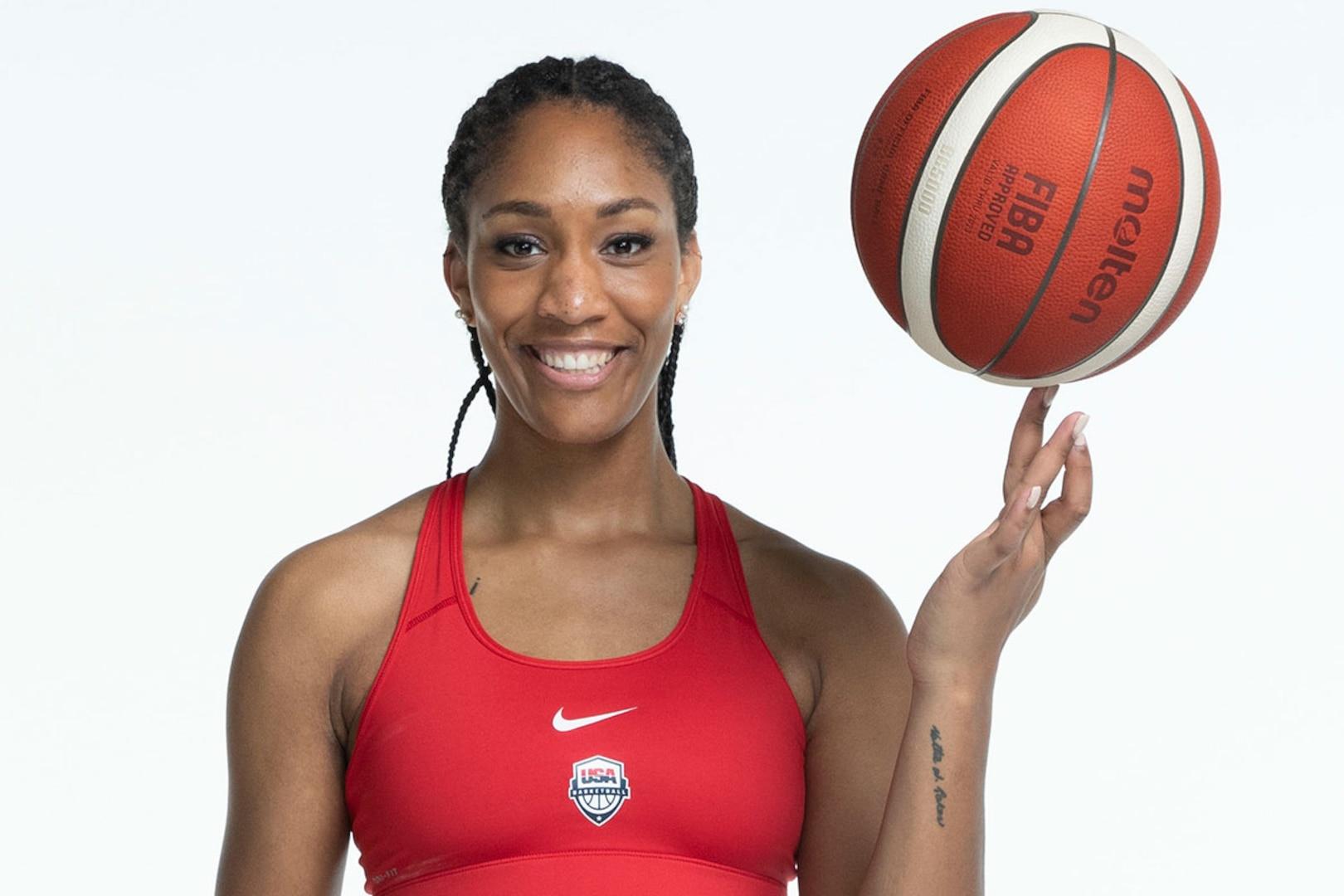 A'ja Wilson balances a basketball and shows the tattoo on her wrist