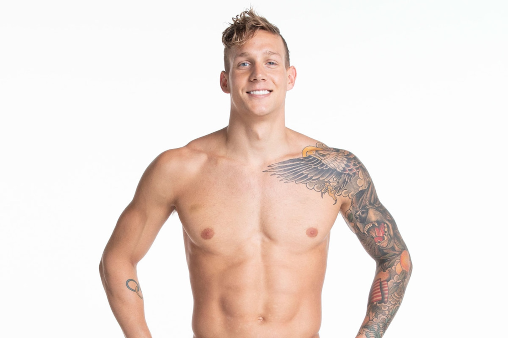 Caeleb Dressel shows off the tattoo sleeve on his arm