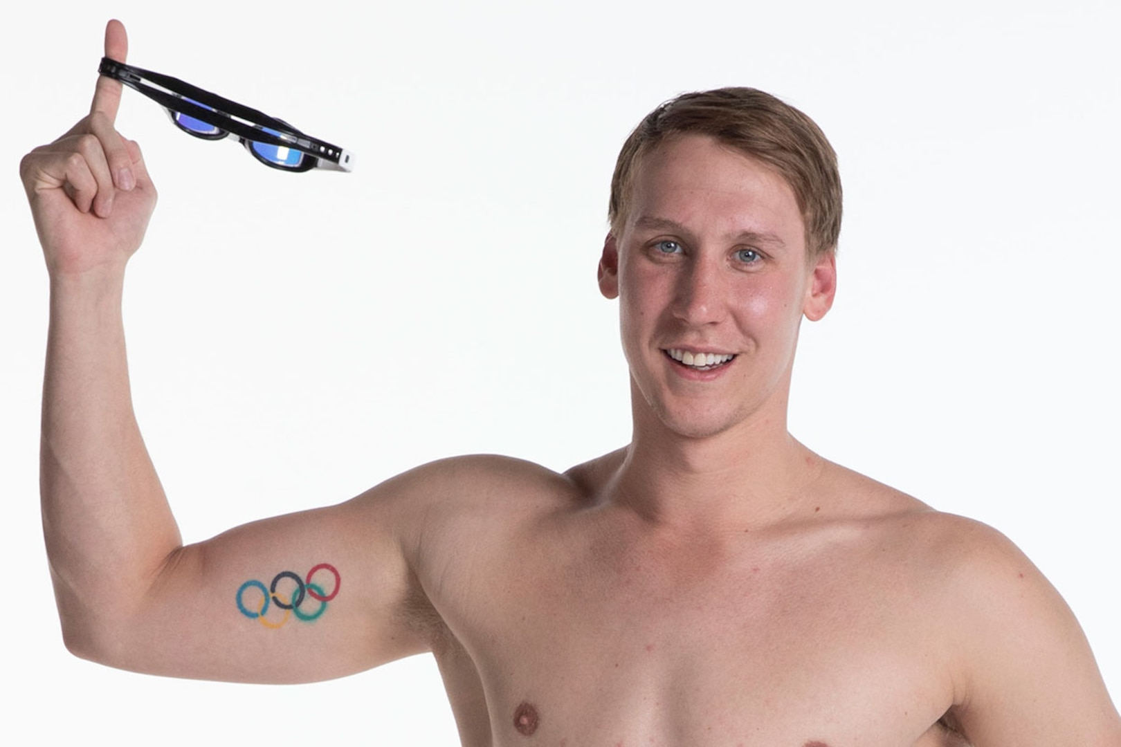 Chase Kalisz shows off the Olympic ring tattoo on his bicep