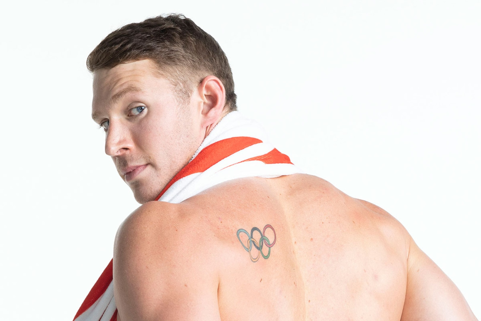 Ryan Murphy shows off the tattoo on his back