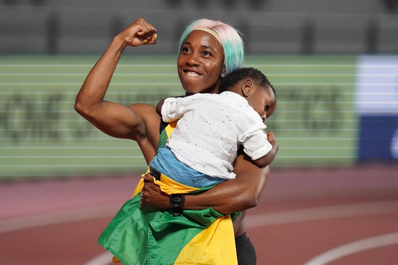 Shelly-Ann Fraser-Pryce celebrates with son, Zyon, after winning world title