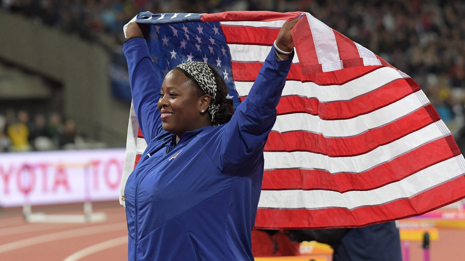 Aug 9, 2017; London, United Kingdom; Michelle Carter (USA) poses with United States flag after placing third in the womens shot put during the IAAF World Championships in Athletics at London Stadium at Queen Elizabeth Park. Mandatory Credit: Kirby Lee-USA TODAY Sports