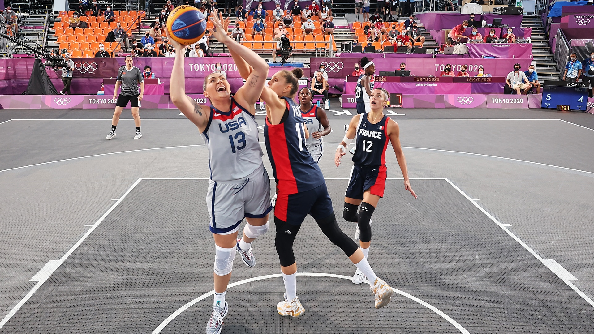 Stephanie Dolson draws a foul against France in the United States' opening match of 3x3 basketball pool play.