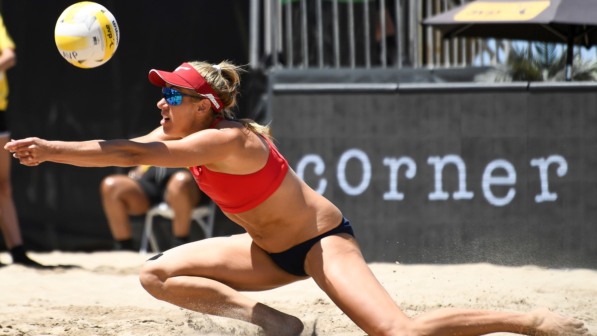 April Ross returns a shot in a match with Terese Cannon and Kelly Reeves during the 2019 AVP...