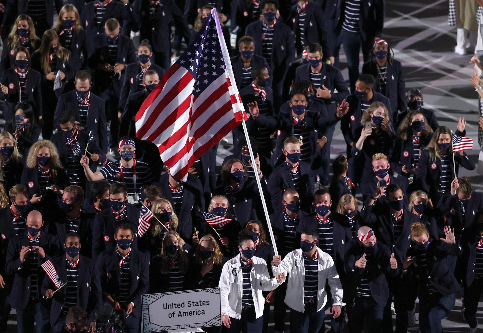 TOKYO, JAPAN - JULY 23: Flag bearers Sue Bird and Eddy Alvares of Team United States lead their team out during the Opening Ceremony of the Tokyo 2020 Olympic Games at Olympic Stadium on July 23, 2021 in Tokyo, Japan.