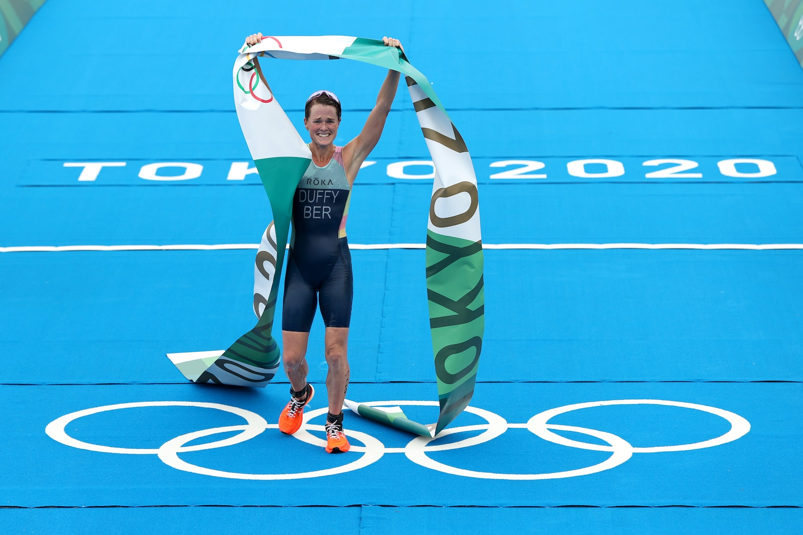 Flora Duffy of Team Bermuda celebrates winning the gold medal during the Women's Individual Triathlon
