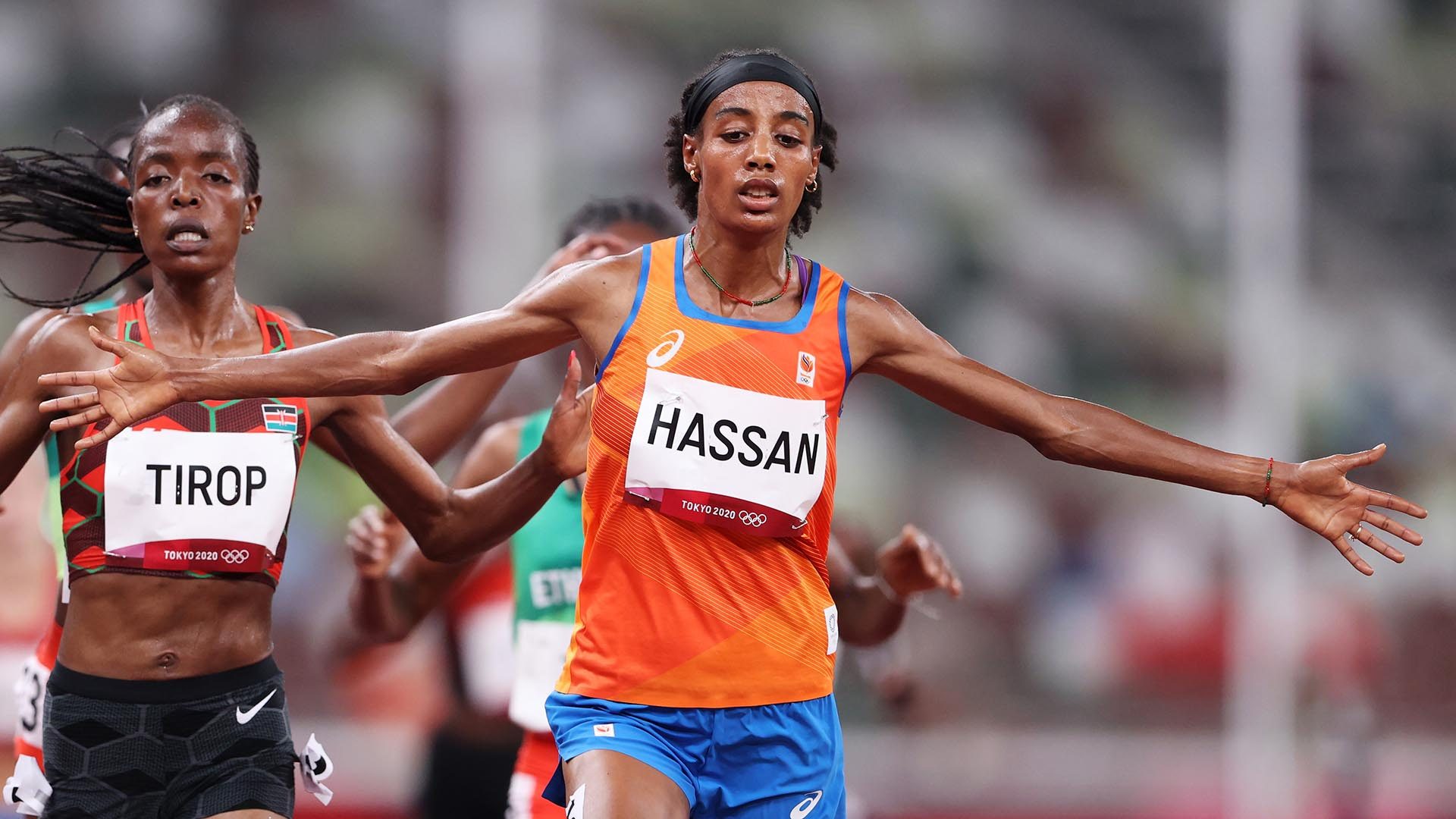 TOKYO, JAPAN - JULY 30: Sifan Hassan of Team Netherlands crosses the finish line first ahead of...