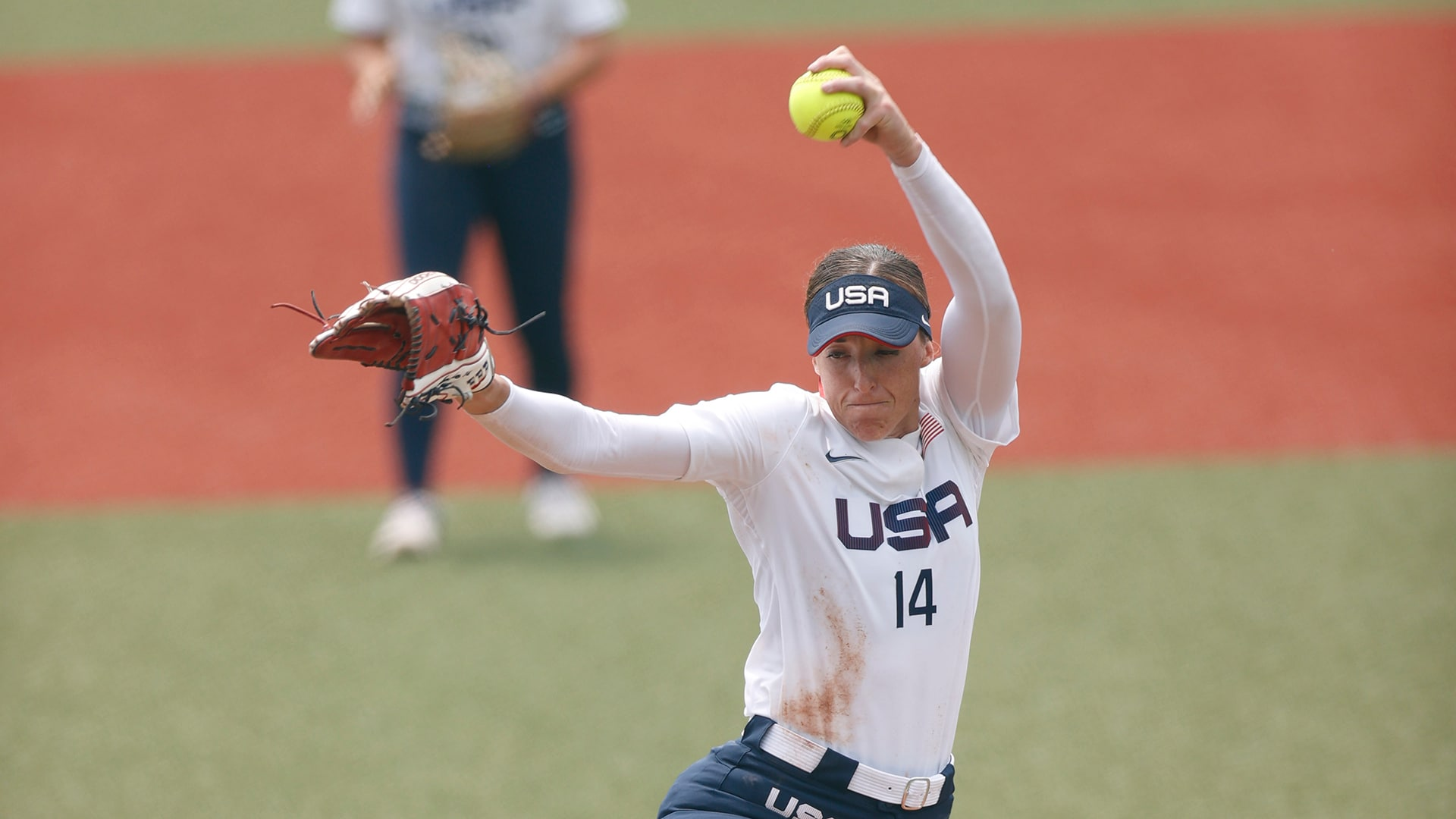 USA player Monica Abbott (14) delivers a pitch during the Tokyo 2020 Olympic Summer Games at Fukushima Azuma Stadium.