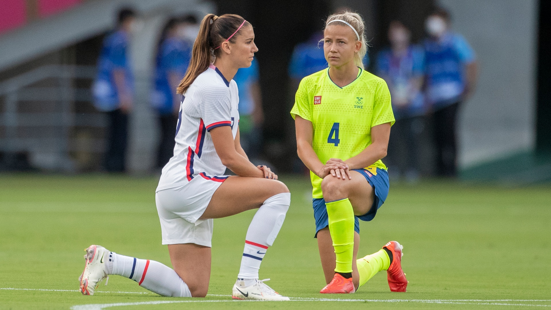 Alex Morgan. #13 of the United States and Hanna Glas #4 of Sweden take a knee before the start of the USA V Sweden group G soccer game at Tokyo Stadium during the Tokyo 2020 Olympics