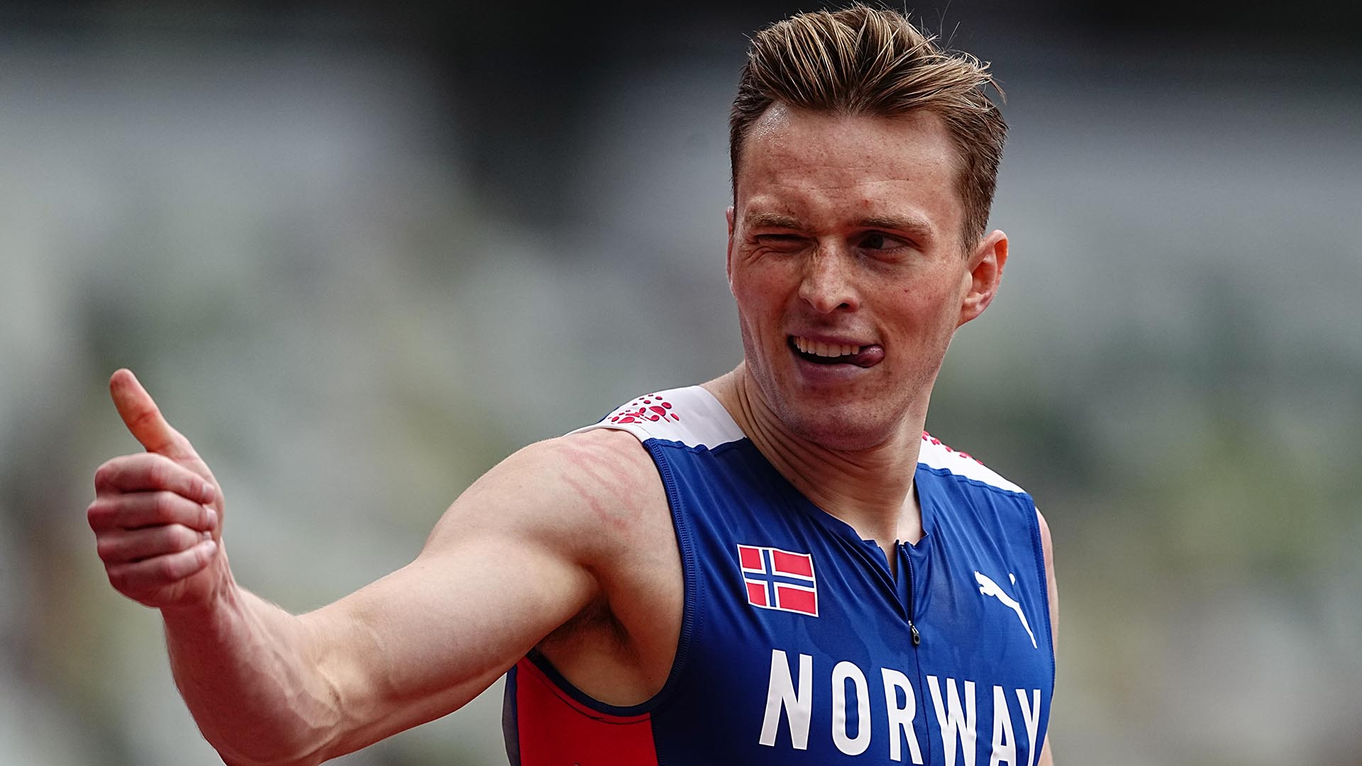 30 July 2021, Japan, Tokio: Athletics: Olympics, preliminaries, 400 m hurdles, men, heats at the Olympic Stadium. Karsten Warholm from Norway gives a thumbs up after his run. Photo: Michael Kappeler/dpa (Photo by Michael Kappeler/picture alliance via Getty Images)