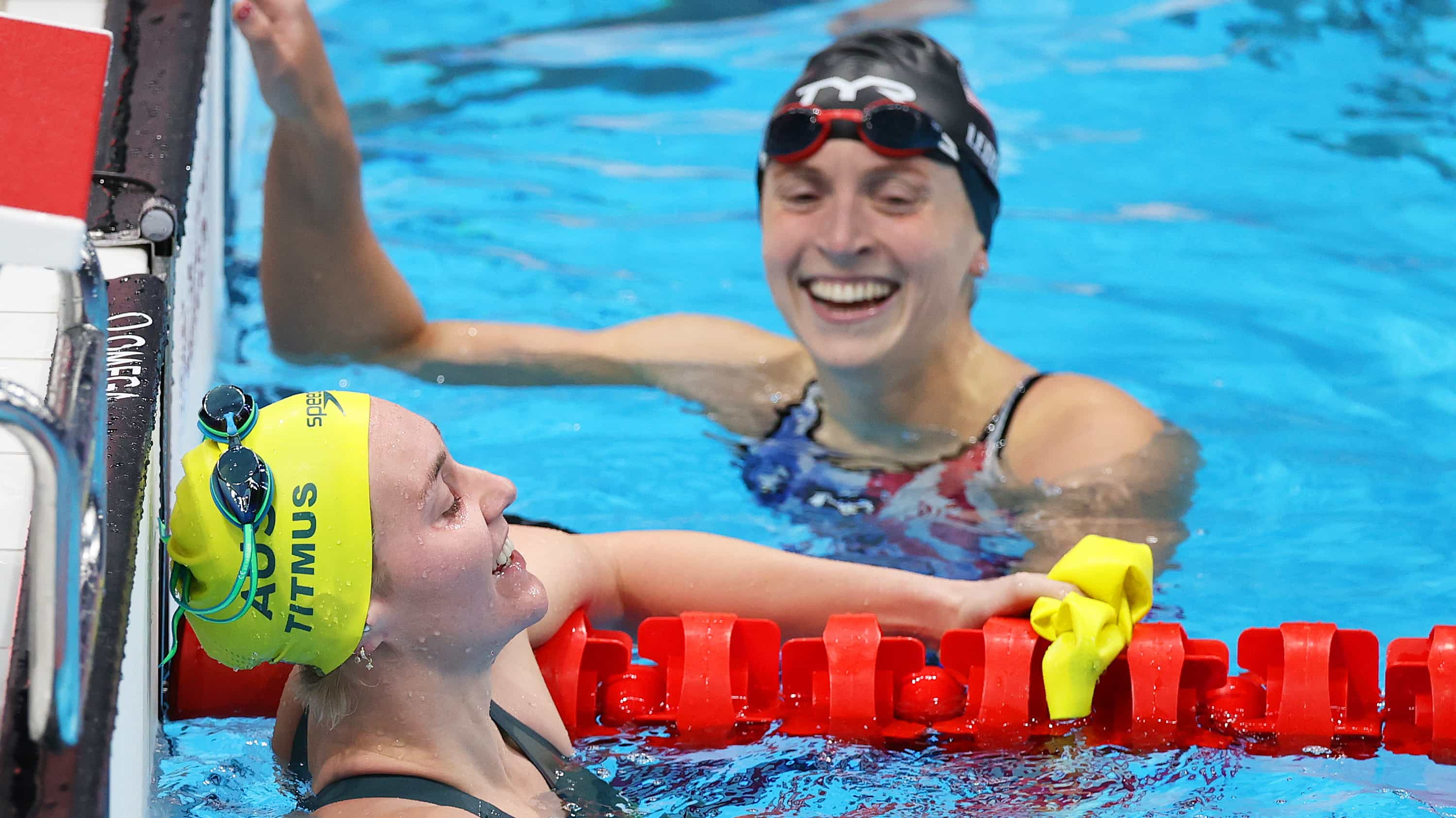 Ariarne Titmus and Katie Ledecky react after competing in the Women's 400m freestyle final in...