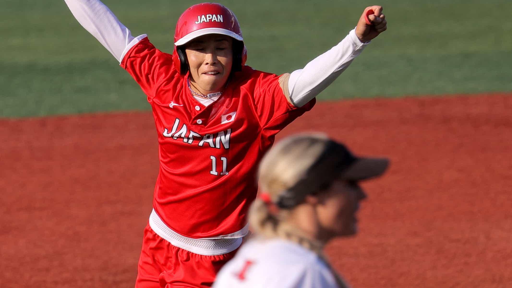 Japan's Eri Yamada celebrates her walk-off single beside Canada's Kelsey Harshman. (credit:...