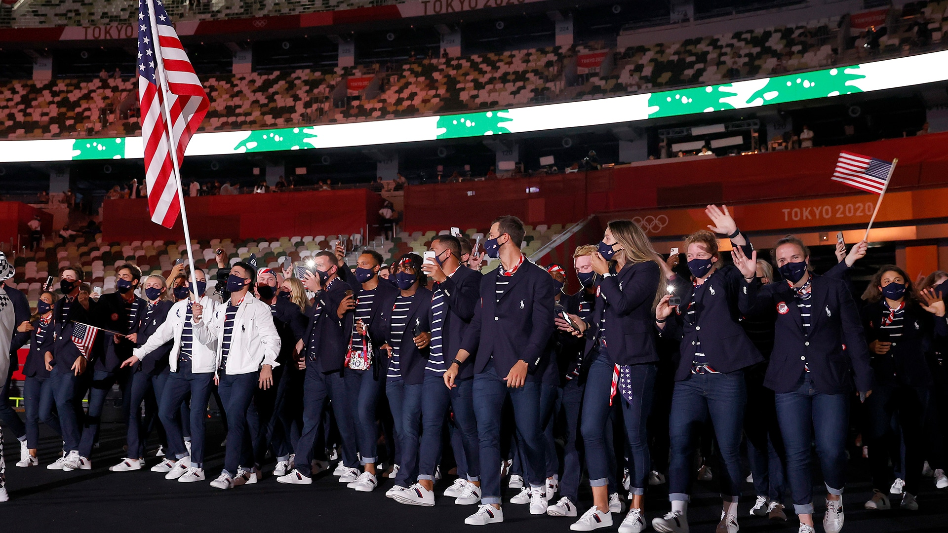 Sue Bird and Eddy Alvarez lead the USA during the Parade of Nations. (credit: Jamie...