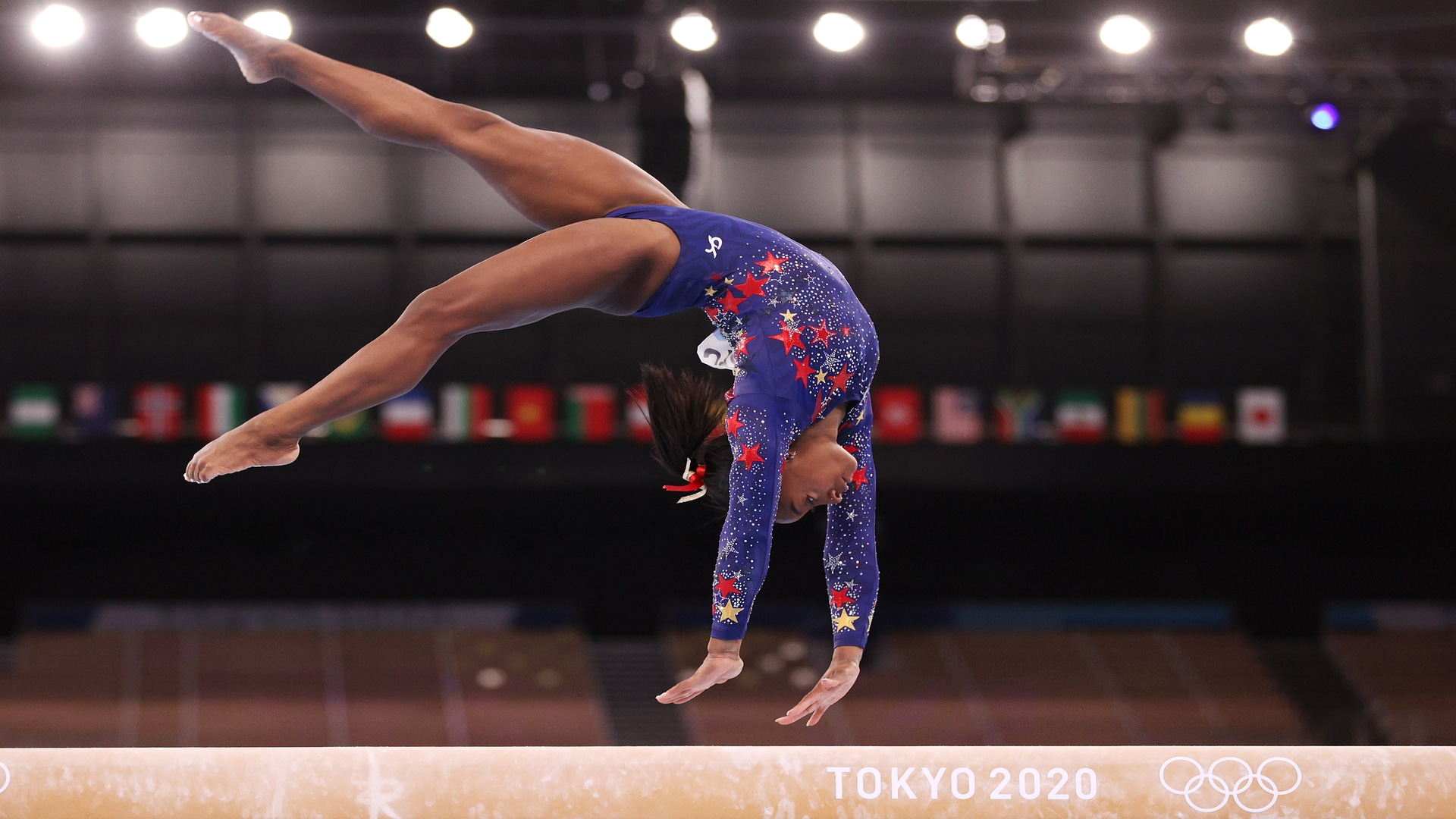 Simone Biles performs a back-handspring on balance beam during the qualification round of the...