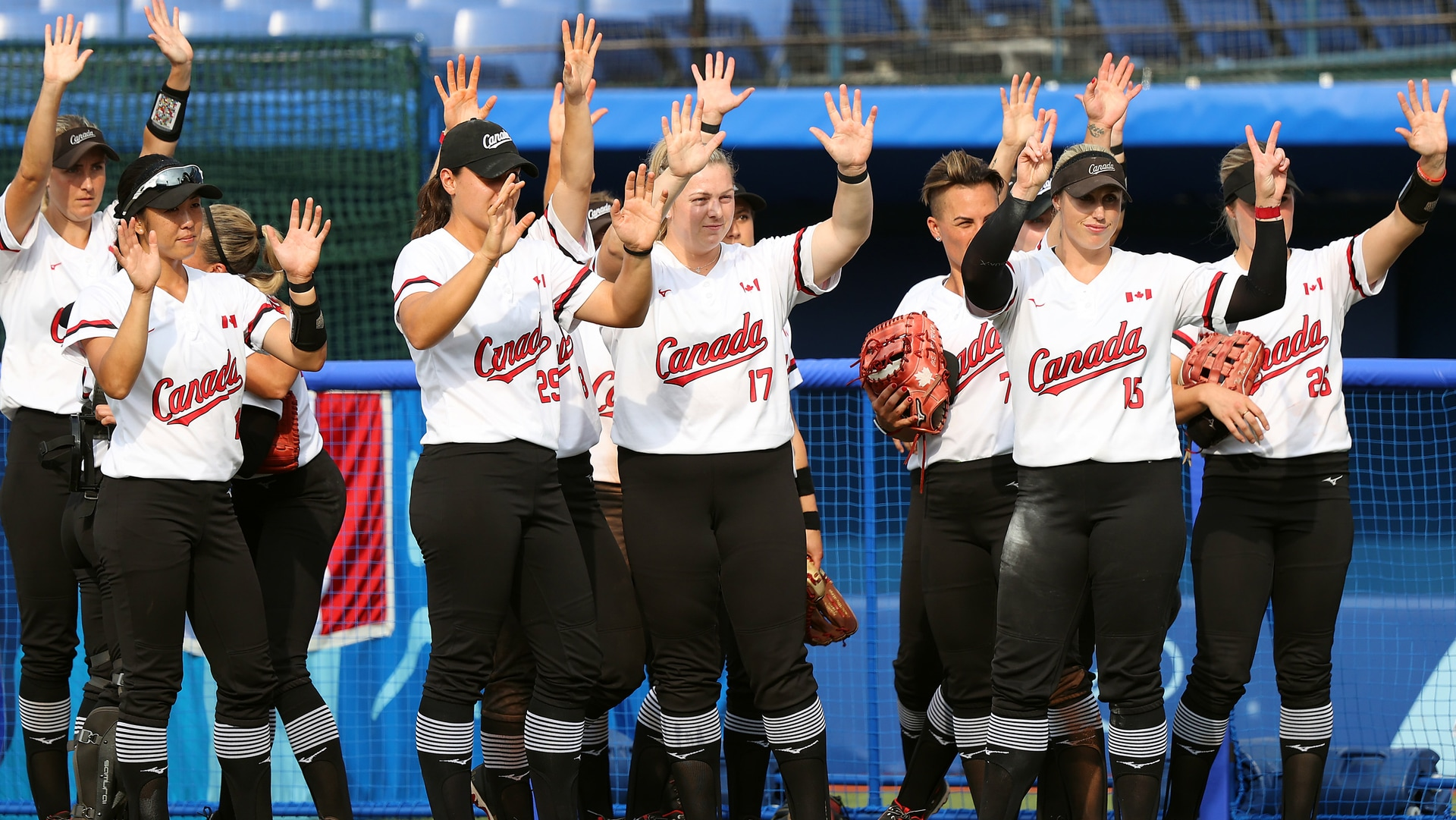 Team Canada wave to Team Italy after their game during softball opening round on day three of...