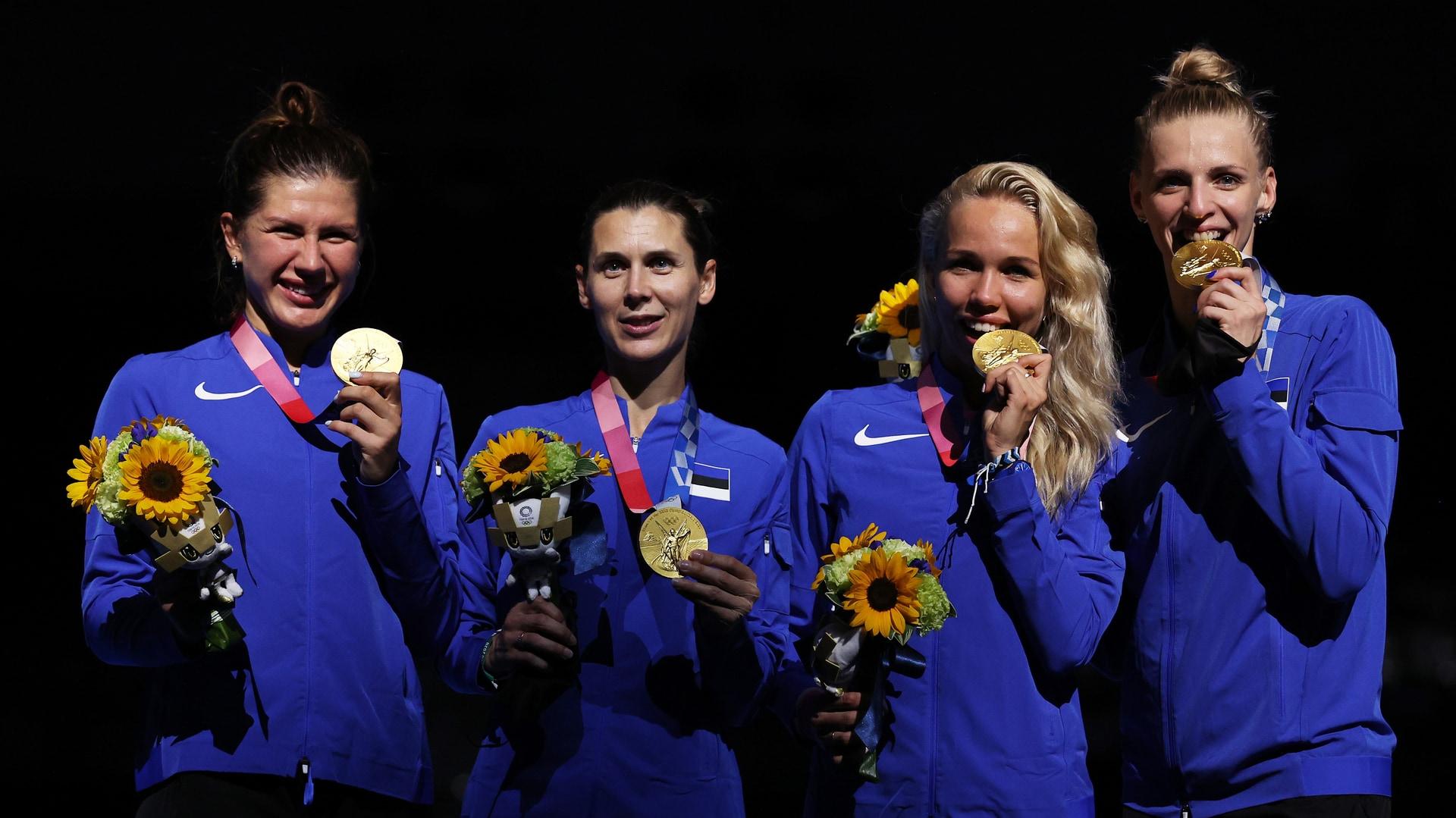 (L-R) Gold medalists Julia Beljajeva, Irina Embrich, Erika Kirpu and Katrina Lehis of Team...