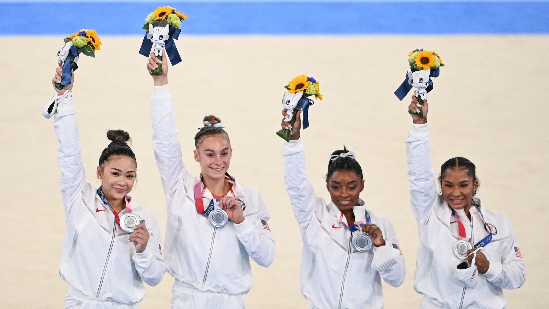 Sunisa Lee, Grace McCallum, Simone Biles and Jordan Chiles celebrate winning the silver medal during the podium ceremony of the artistic gymnastics women's team final during the Tokyo 2020 Olympics