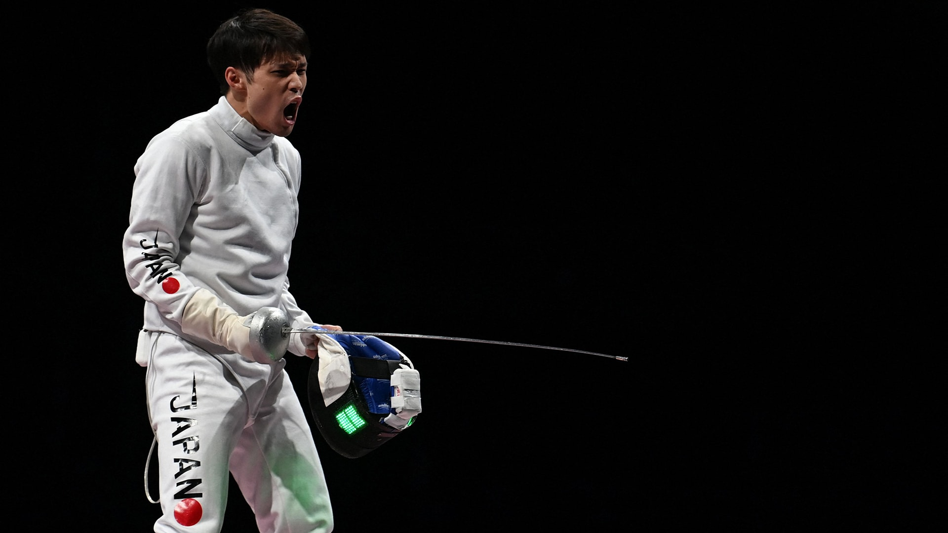 Japan's Masaru Yamada reacts during the match against Russia's Sergey Bida in the men's epee...
