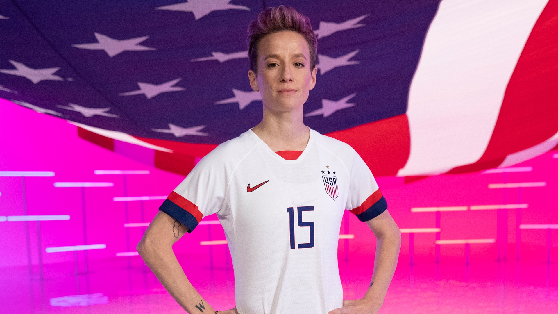 Megan Rapinoe hoisted an imaginary American flag as she and USWNT teammate Abby Dahlkemper...