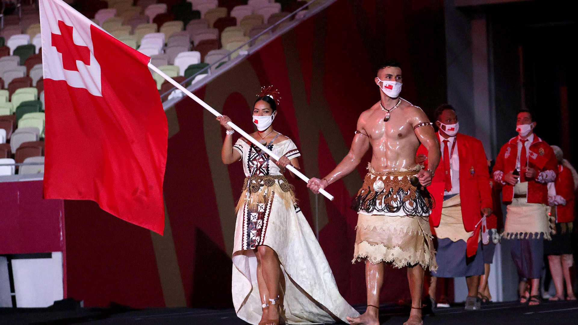 TOKYO, JAPAN - JULY 23: Flag bearers Malia Paseka and Pita Taufatofua of Team Tonga lead their team out during the Opening Ceremony of the Tokyo 2020 Olympic Games at Olympic Stadium on July 23, 2021 in Tokyo, Japan.
