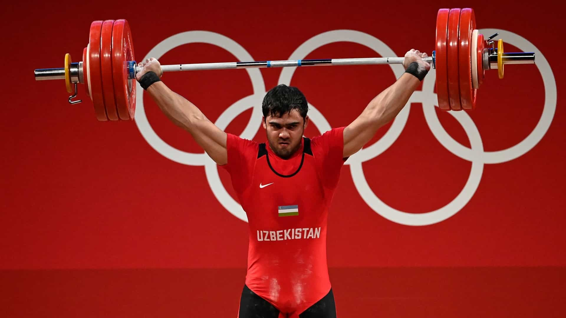 Image for Uzbekistan's Akbar Djuraev wins gold, Olympic records in men's 109 kg