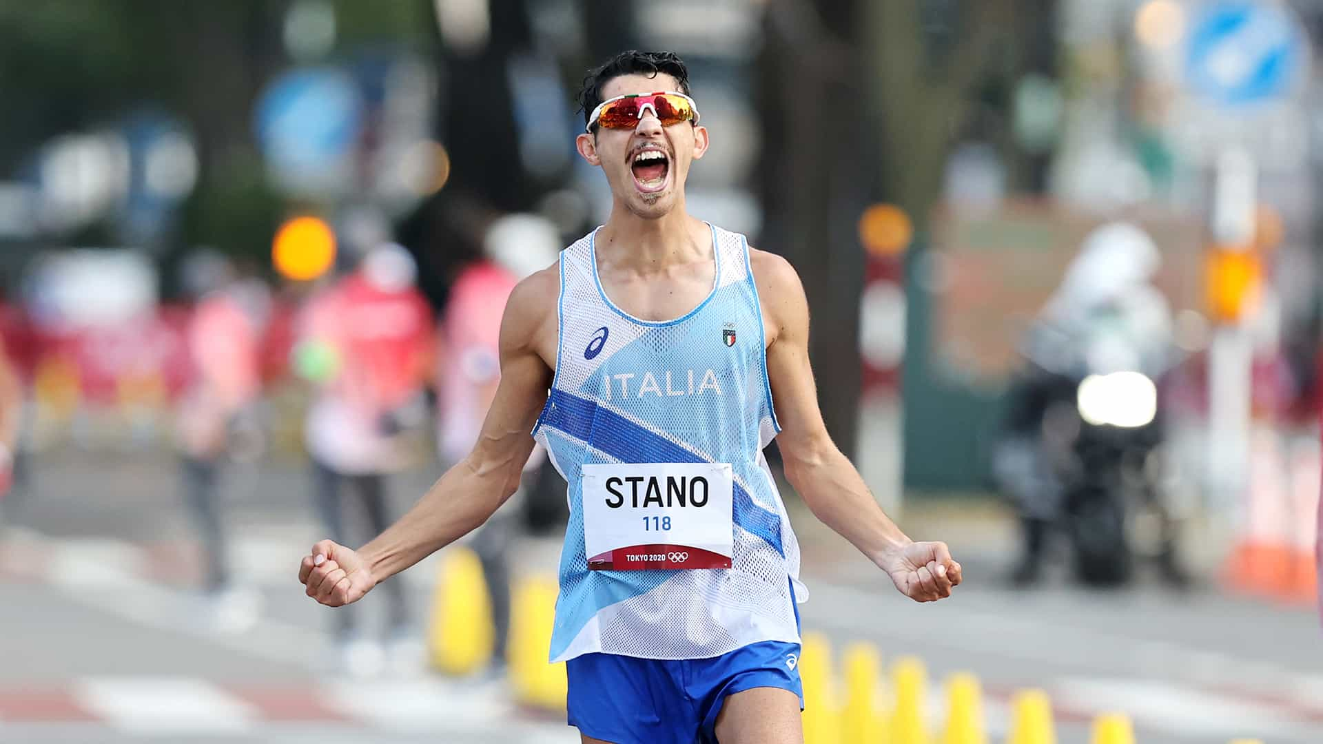 Massimo Stano celebrates his gold medal win in the men's 20km walk. (credit: Getty Images)