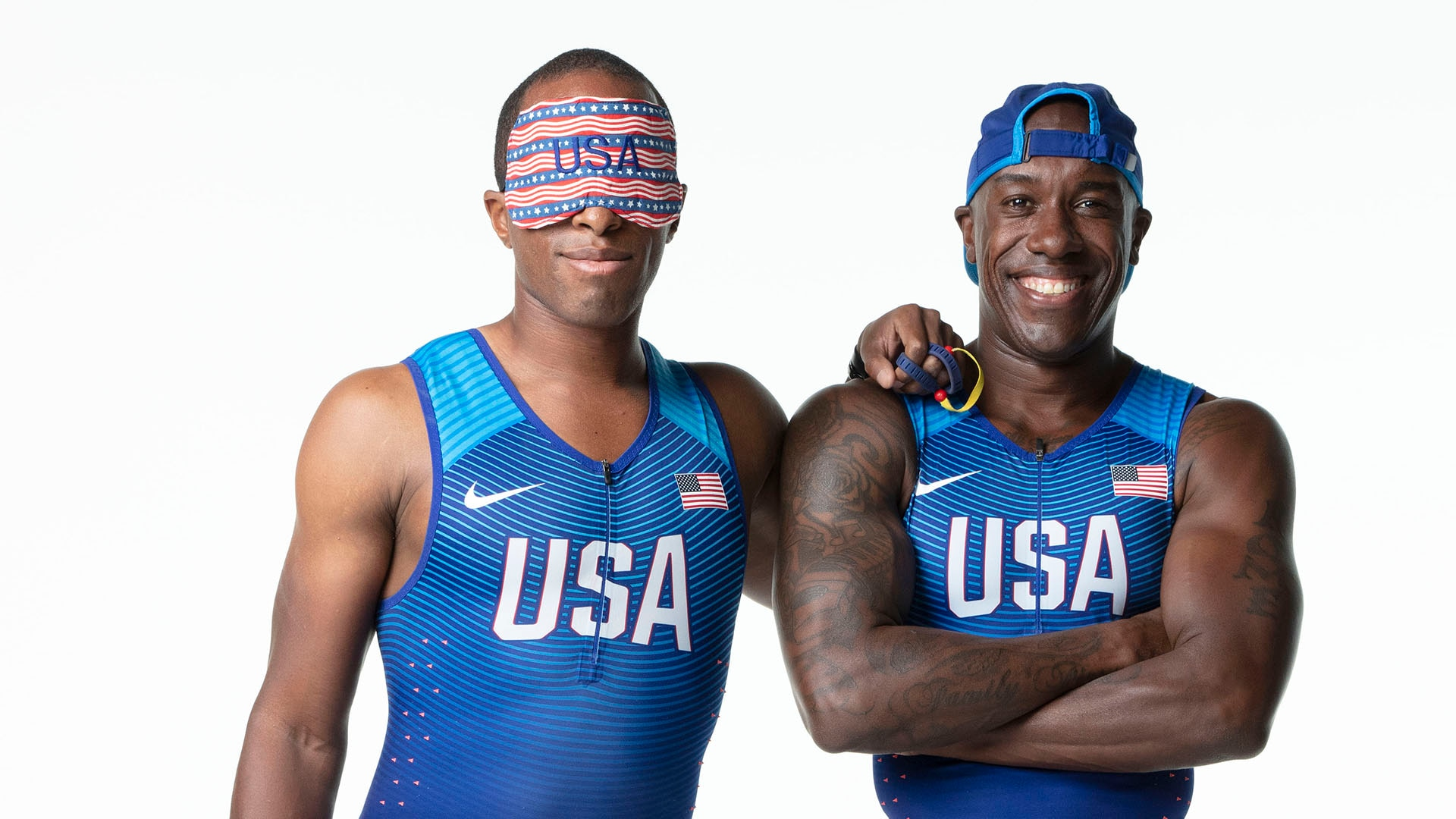 Paralympic track and field athlete David Brown (L) poses outside on a track with guide Jerome Avery (R) during a 2019 photoshoot in Southern California