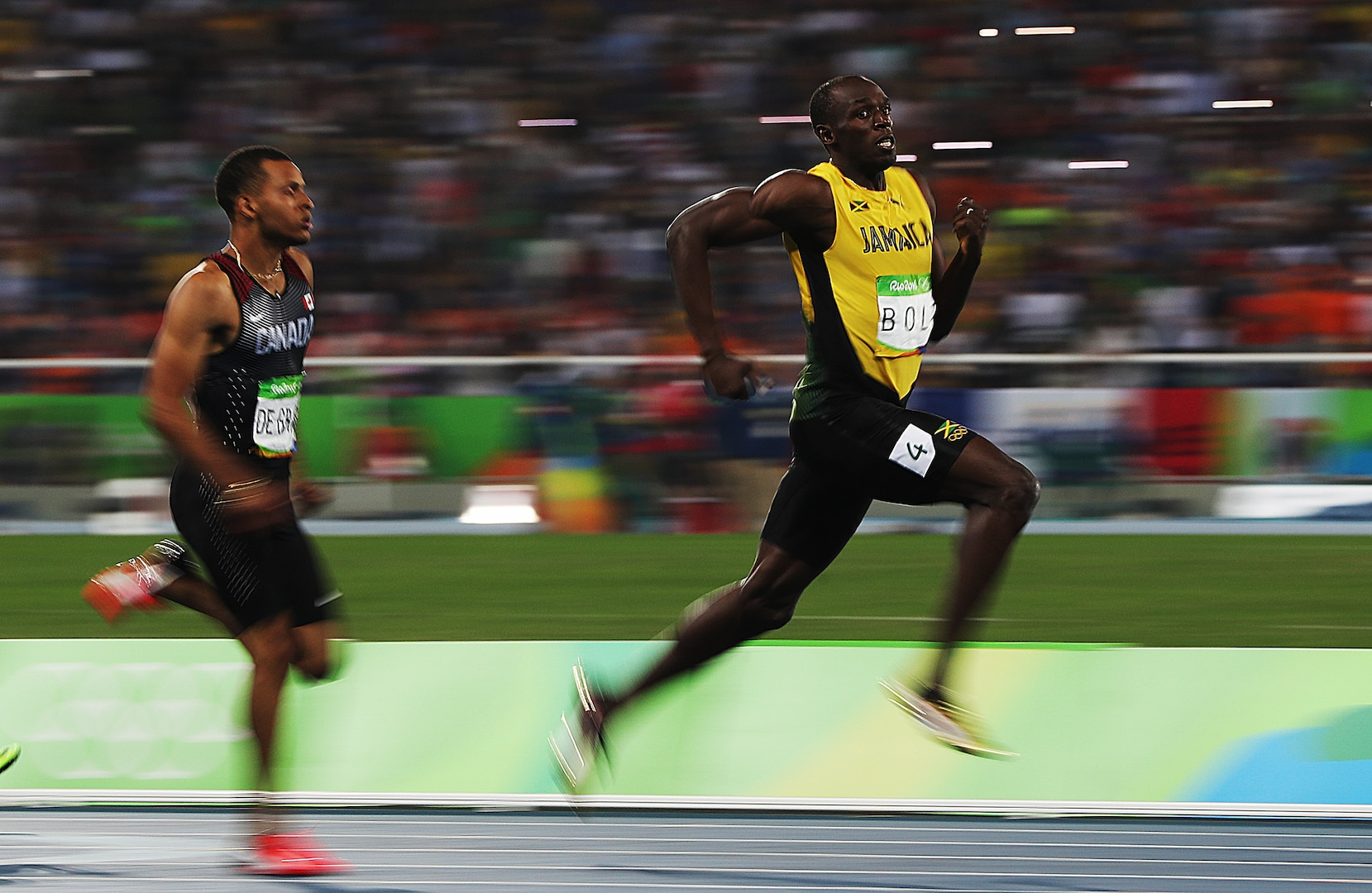 Andre de Grasse and Usain Bolt react as they compete in the Men's 200m Semifinals on Day 12 of the Rio 2016 Olympic Games