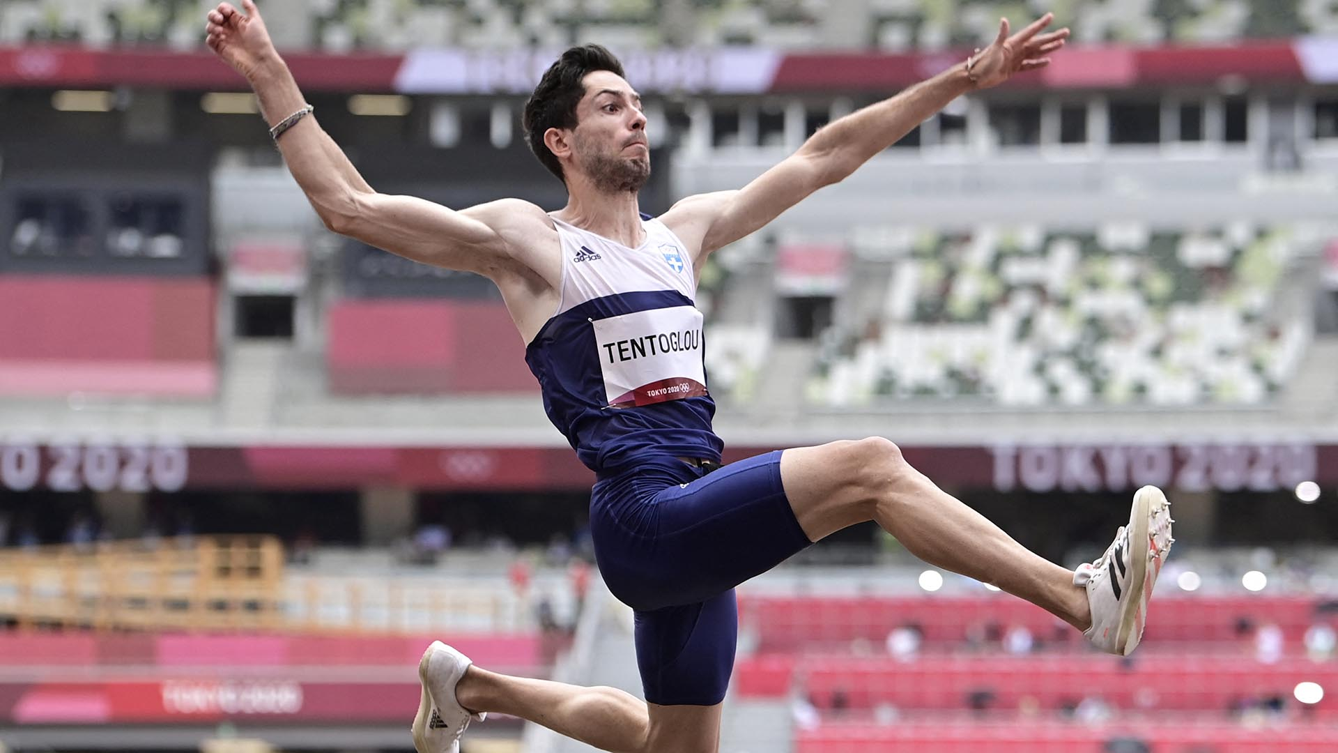 Greece's Miltiadis Tentoglou competes in the men's long jump final during the Tokyo 2020...