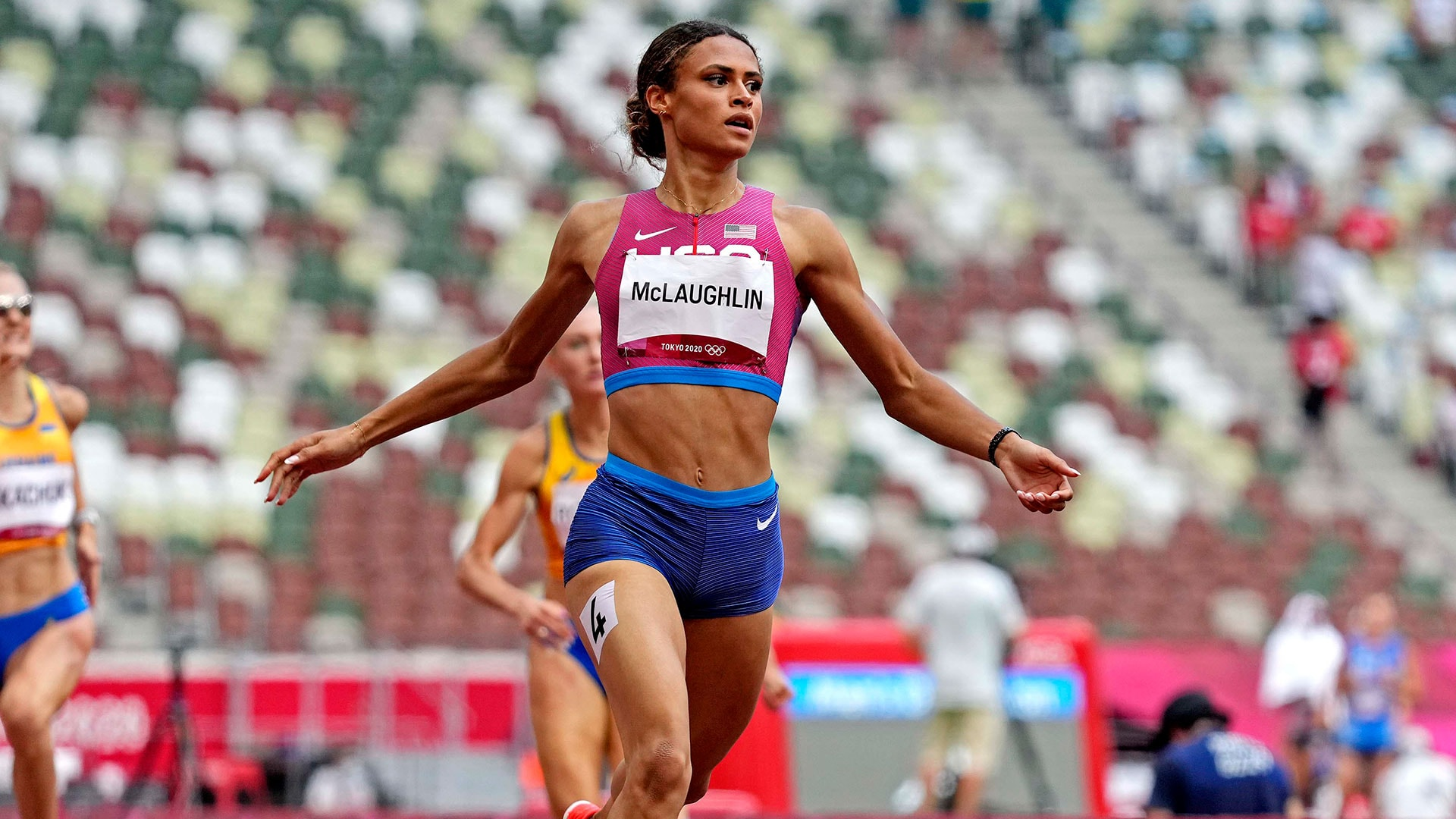 American Sydney McLaughlin downed her own world record, claiming the Olympic title in the...