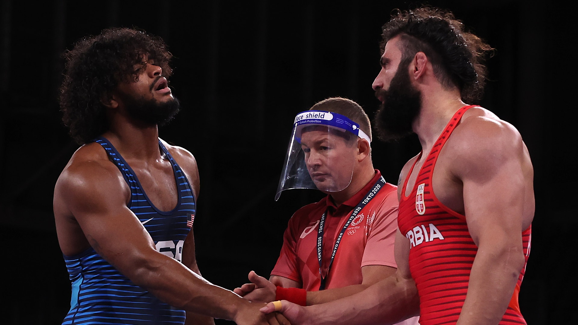 G'Angelo Hancock of Team USA shakes hands with Mihail Kajaia of Serbia after his victory during...