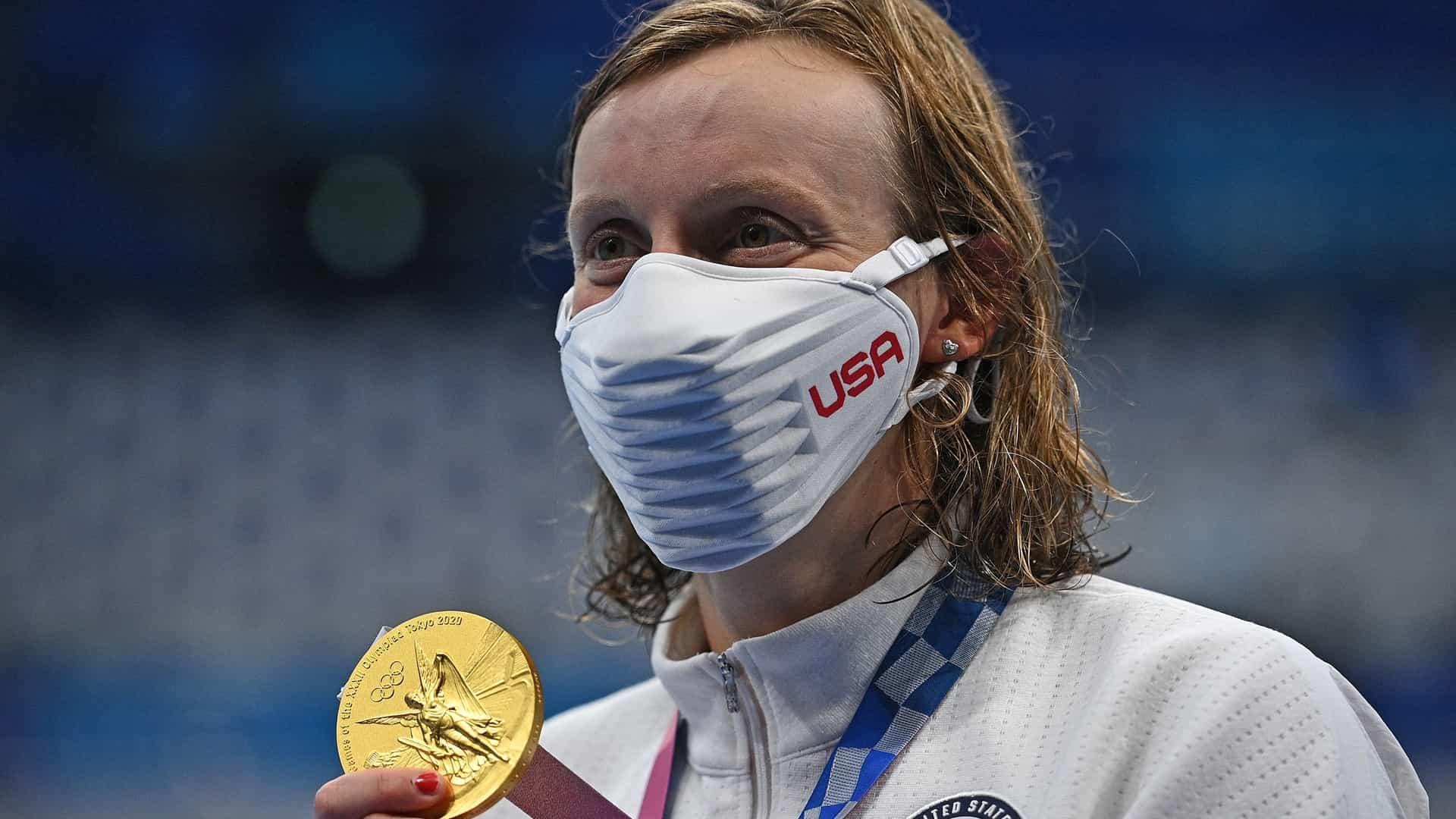 Katie Ledecky shows off her gold medal.