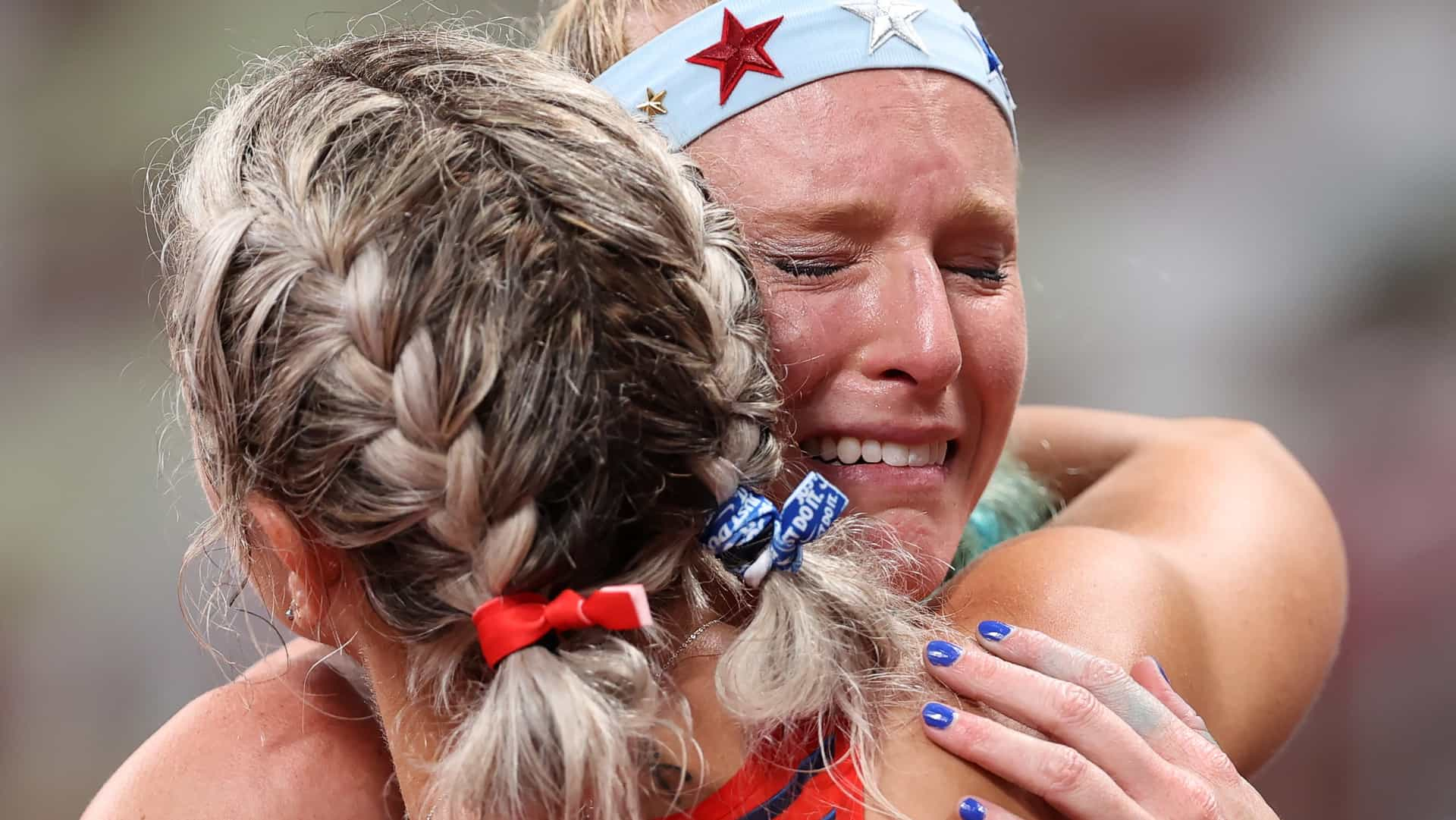 A dejected Sandi Morris hugs a fellow competitor after failing to qualify in women's pole...