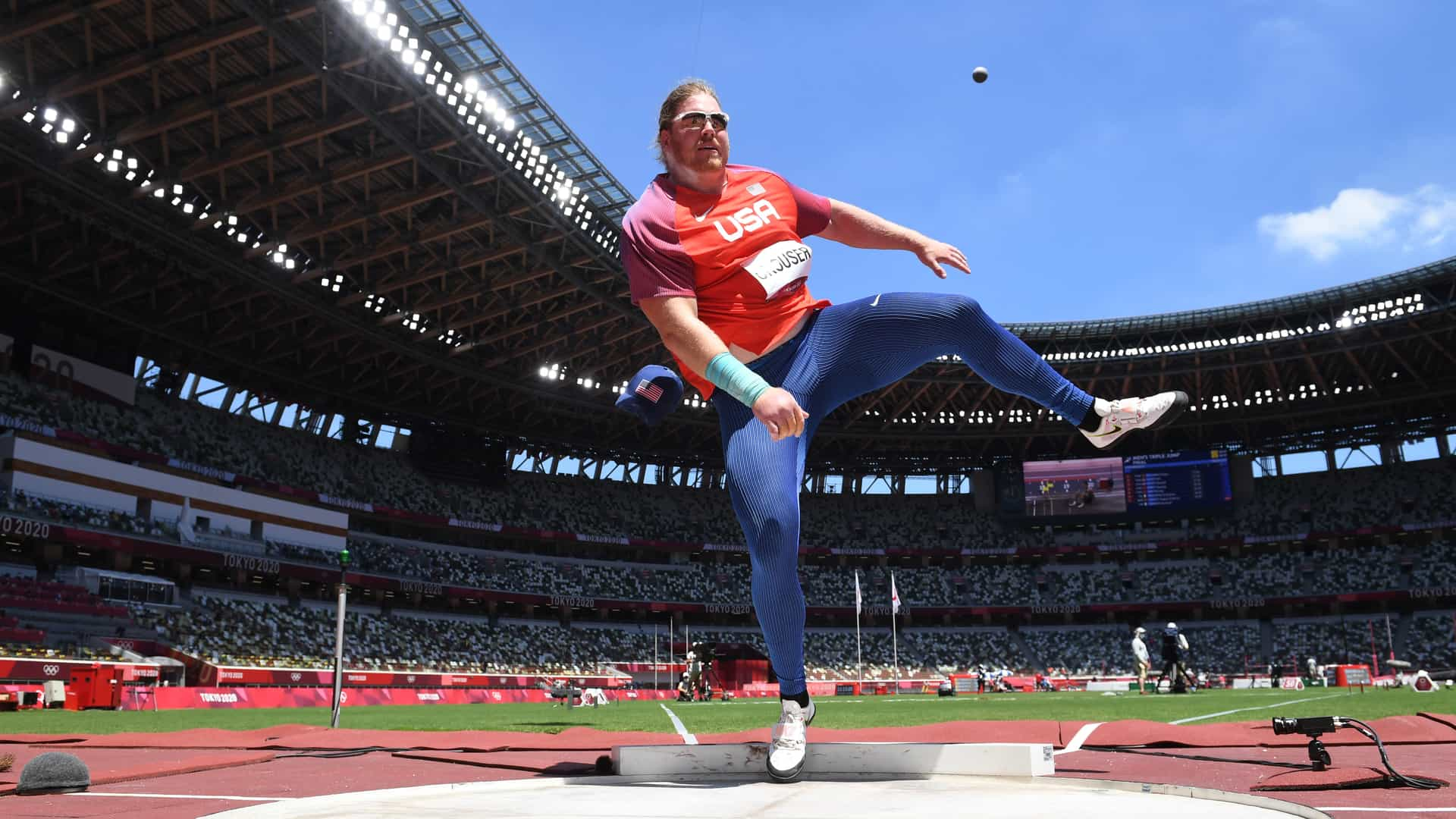 Ryan Crouser finishes his rotation while his shot flies through the air Thursday at the Tokyo...