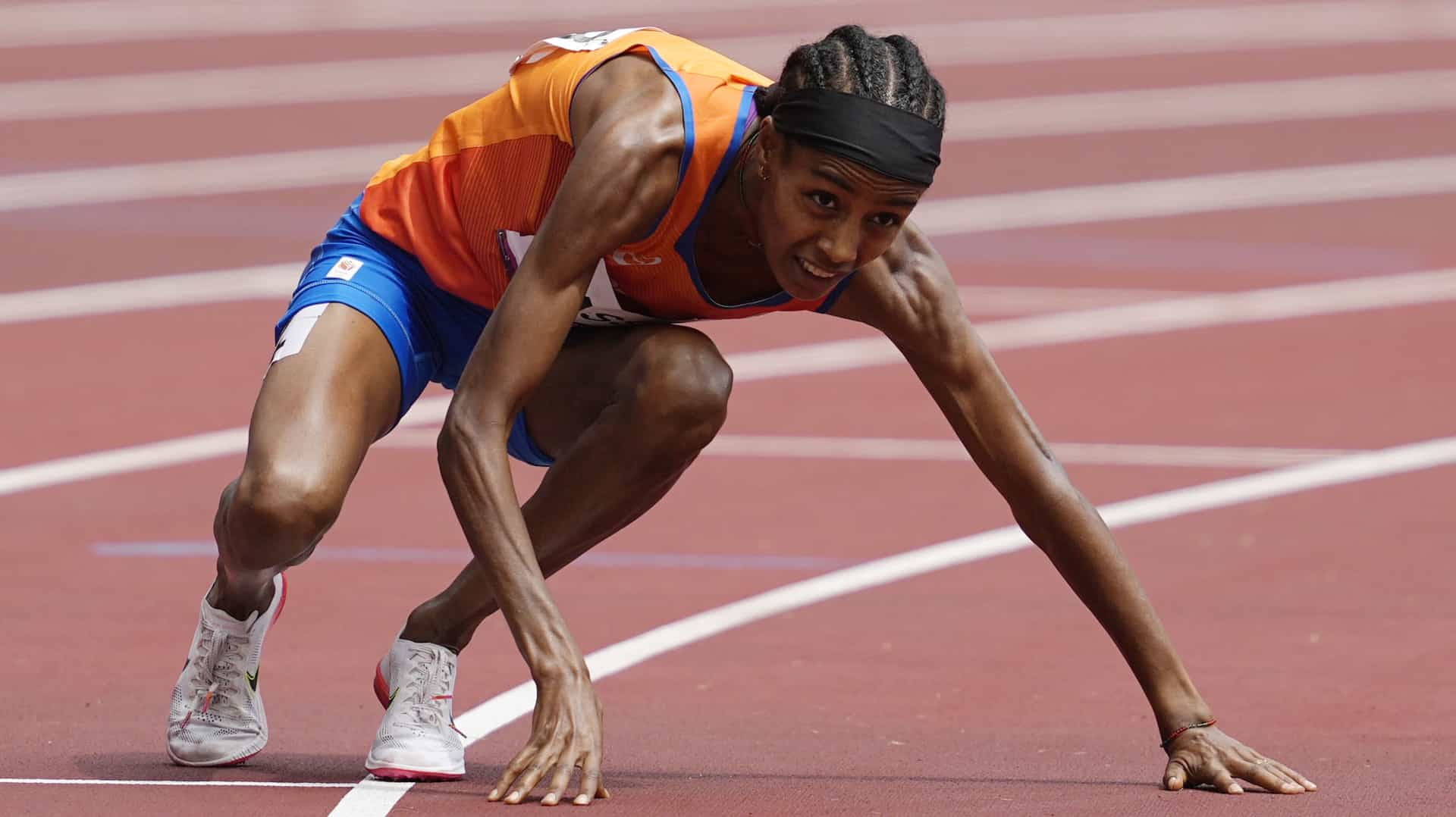 Sifan Hassan gets up after falling to the track in the women's 1500m preliminaries Monday at...