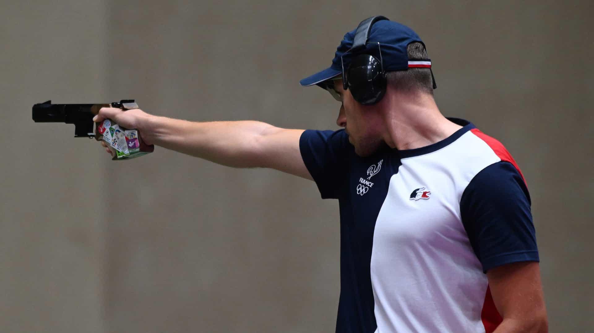 Jean Quiquampoix fires at targets in the men's rapid-fire pistol event. (credit: Swen Pförtner,...