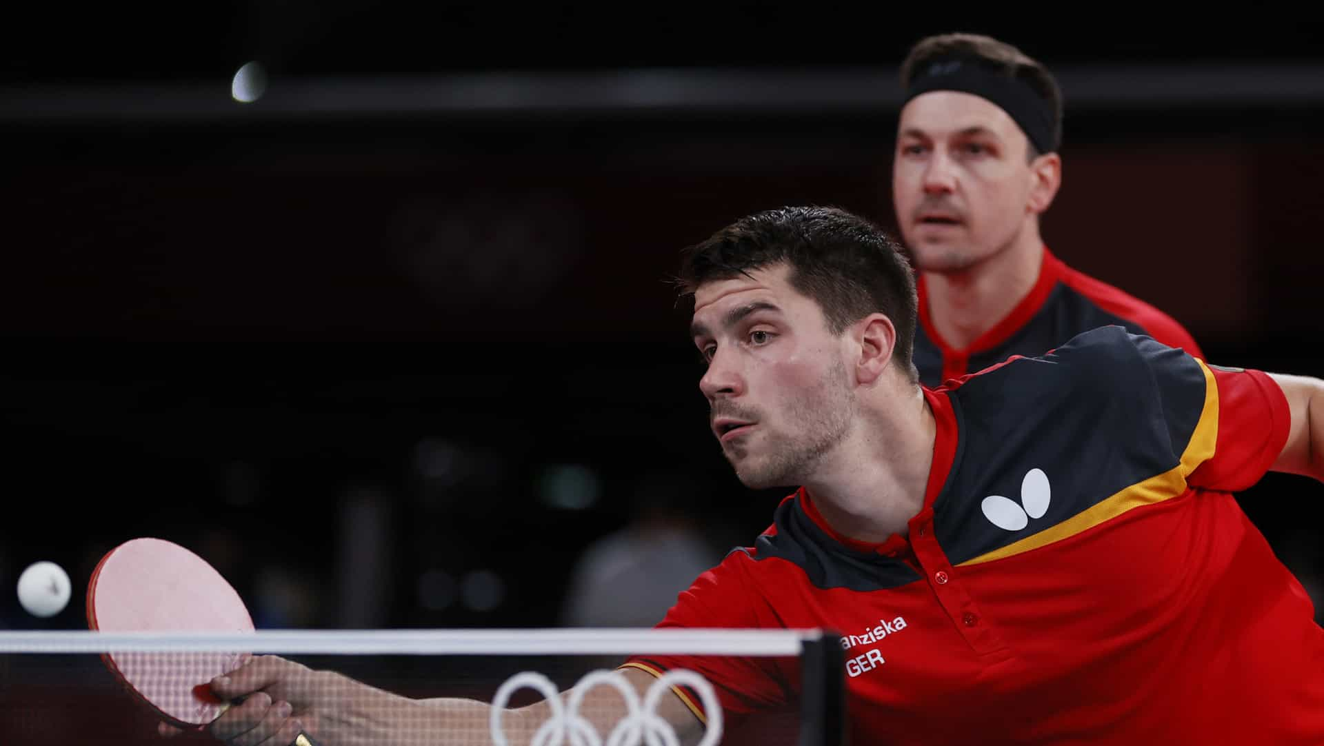 Dimitrij Ovtcharov (front) and Timo Boll (back) play for Germany in the Olympic team table...