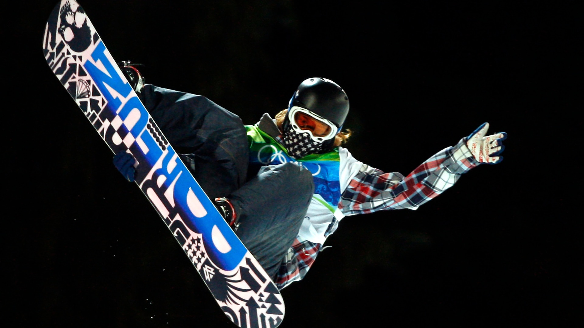 Shaun White competes in the finals of the men's snowboard halfpipe.